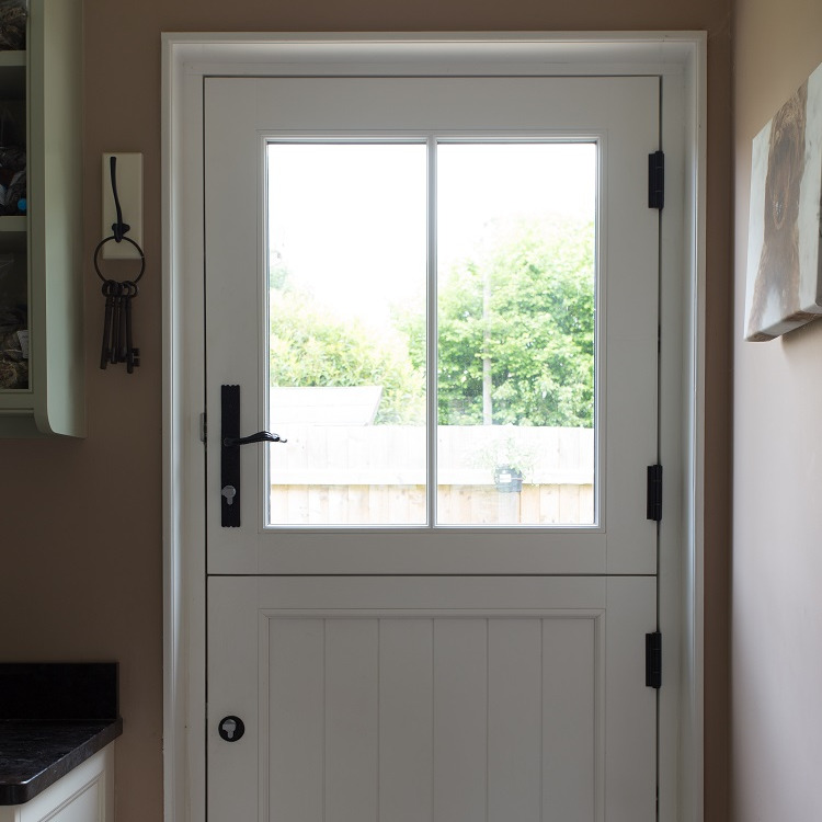 Internal shot of timber stable door with wrought iron hardware