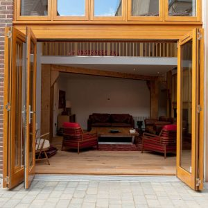Timber Bifold Door made from Accoya and stained - open view