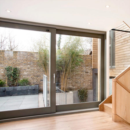 contemporary timber sliding doors new build
