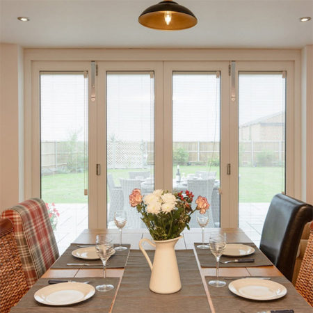 timber bifold doors in dining room