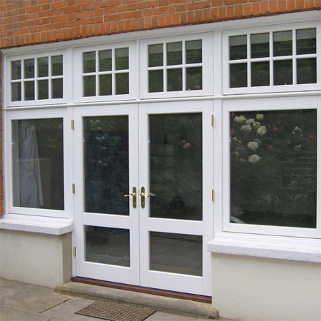traditional timber french doors with side and fan lights and astragal bars