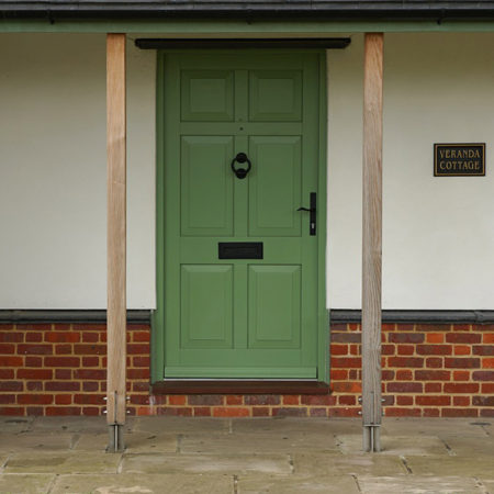 traditional six panel timber entrance door wrought iron hardware