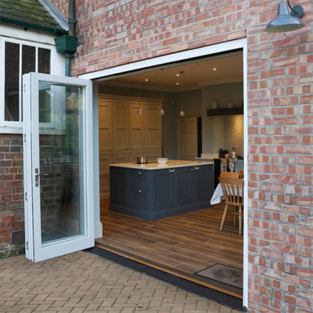 traditional timber bifold doors open