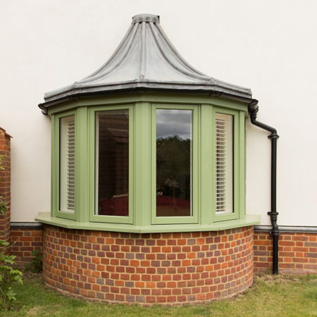 traditional timber casement windows finished in green bow design