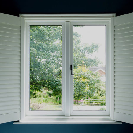 traditional timber casement windows with shutters