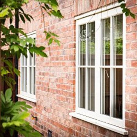 wooden casement windows with astragal bar design