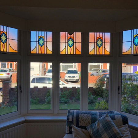 replacement timber casement windows with stained glass